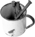 cup with nails