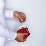Woman Dropping Change in Coin Purse